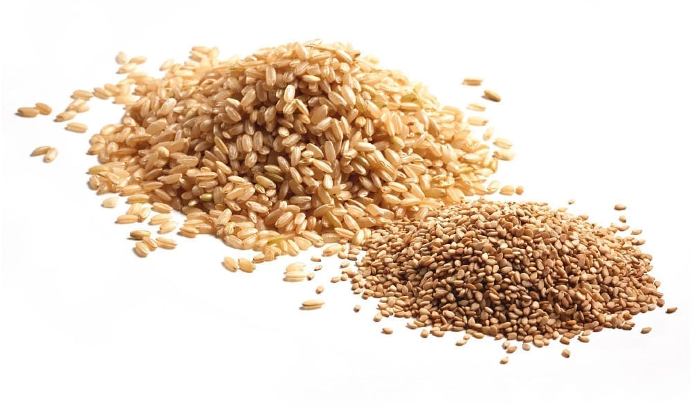 pile of medium grain rice and sesame seeds